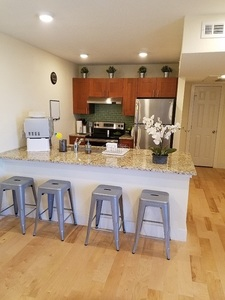 Kitchen with stools and lily
